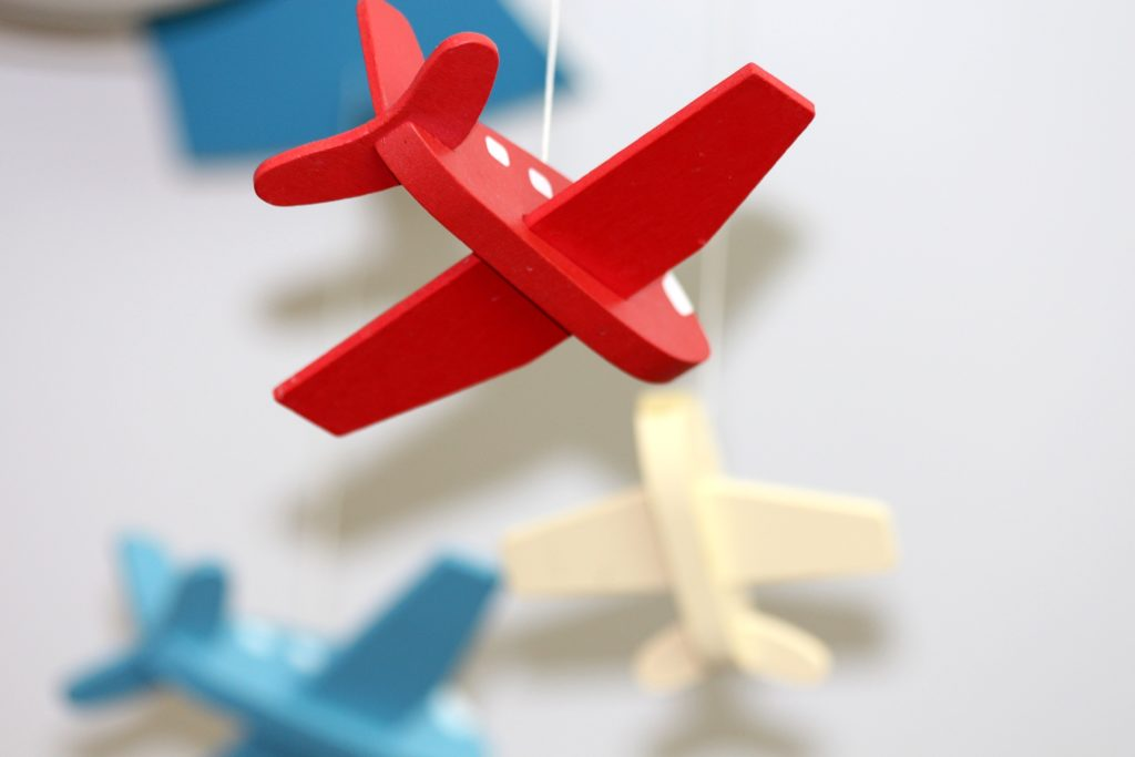 Toy airplanes hang on mobile.